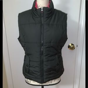 Black puffer vest with Hot Pink interior